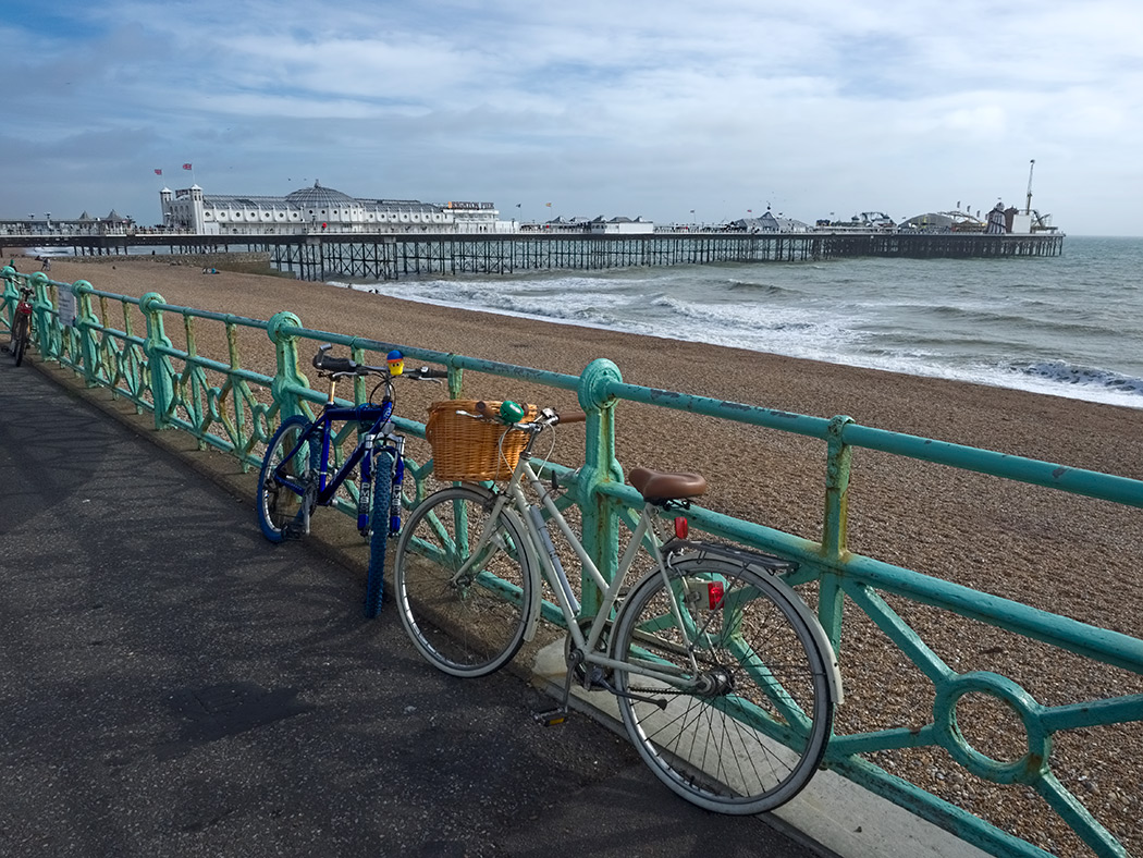 The long strand of Brighton Beach leads to the world famous Brighton Pier in Brighton, England