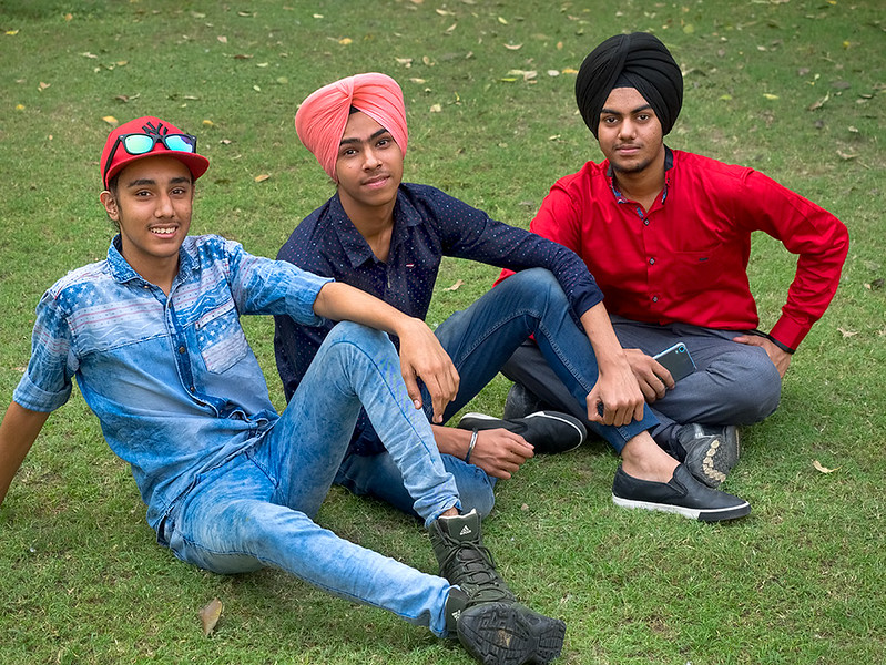 Young men relax on the grounds of the Hauz Khas Archeological Site in South Delhi, India