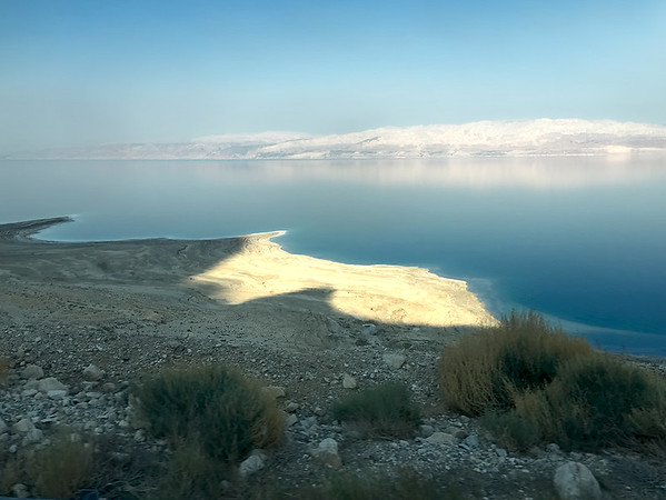 Sunset over the Dead Sea in Israel. Swimming in areas other than designated beaches is very dangerous, as the shoreline is littered with sinkholes that can open up unexpectedly and swallow everything.