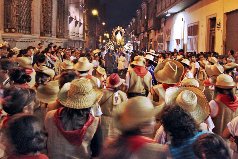 Faithful dance though the streets of Lima for hours behind statue of Virgin de la Puerta