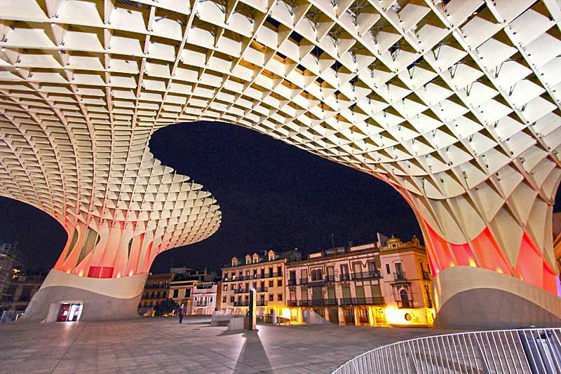 """Metropol Parasol, commonly called """"The Mushroom,"""" offers great night views of Seville, Spain"""