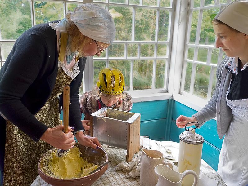 Traditional butter making at Estonian Open Air Museum in Tallinn, Estonia