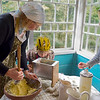 Traditional butter making at Estonian Open Air Museum in Tallinn, Estonia