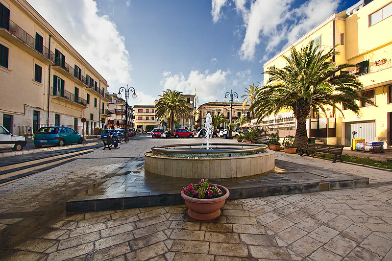 Lovely square in the city center of Pozzallo, Sicily. In addition to having some of the best beaches in Italy, Pozzallo is the embarkation point for the ferry to Valletta, Malta.