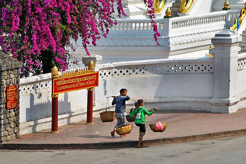 Girls carry goods home from market in Luang Prabang, Laos