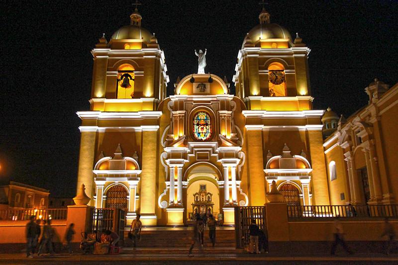 Cathedral shines in dark night skies at Plaza de Armas, Trujillo, Peru