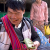 Betel nut vendor at the Nyung Shwe market near Inle Lake, Myanmar. His teeth are stained from chewing the betel nut concoction.n