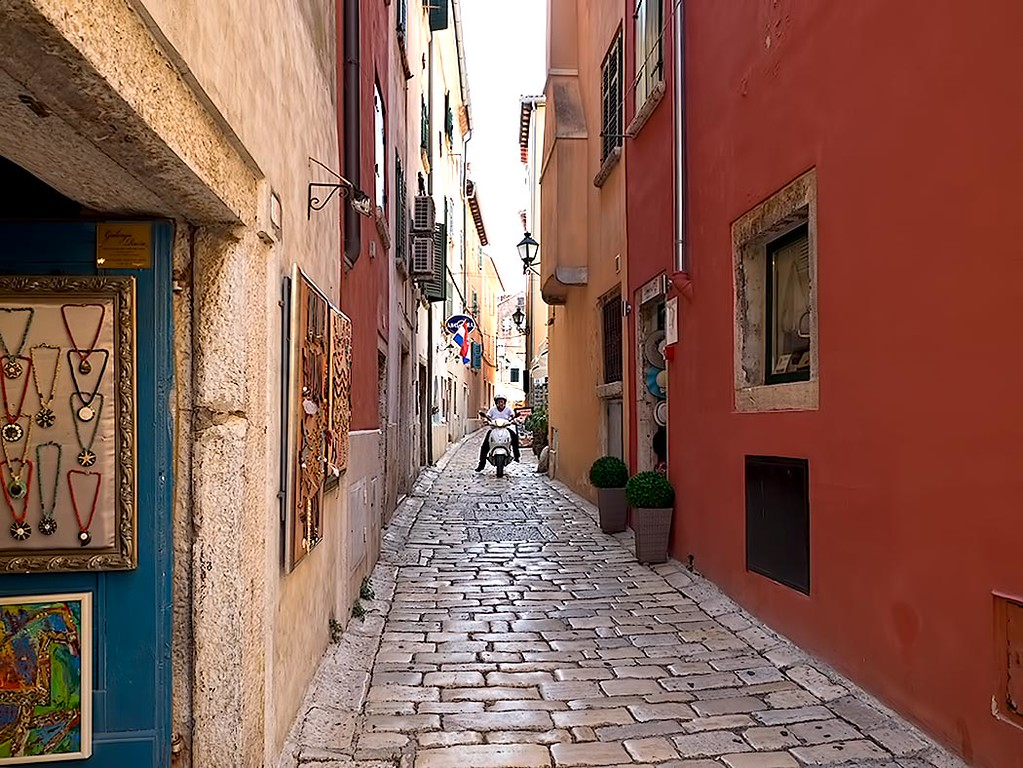 Grisia Street in Rovinj, Croatia, the main road leading to Saint Euphemia Church, which crowns the hill. Grisia Street is renowned for its art galleries and working artists.top town