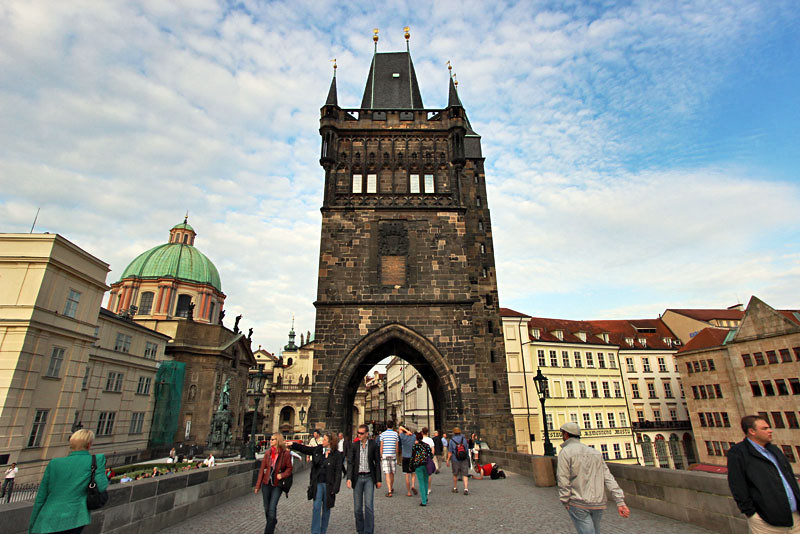 Gothic Old Town guard tower anchors one end of the Charles Bridge in Prague, Czech Republic