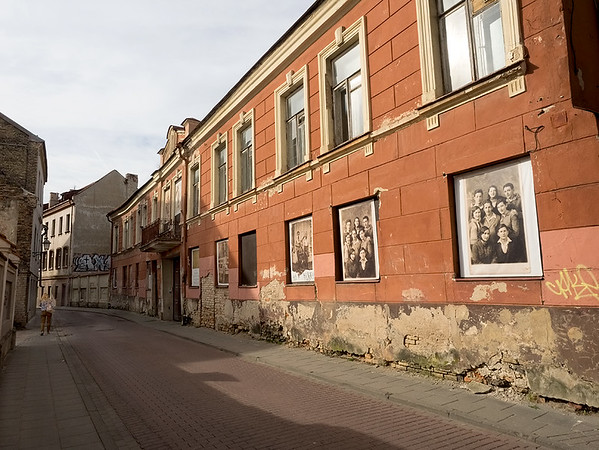 Street in old Jewish ghetto of Vilnius, Lithuania, displays pre-WWII photos of Jewish families who once lived there