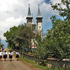 Locals walk down the main road toward the New Church in the village of Breb, Maramures, Romania