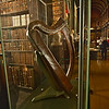Bria Boru Harp, sacred symbol of Ireland, stands on exhibit in the Long Room Library on the campus of Trinity College in Dublin