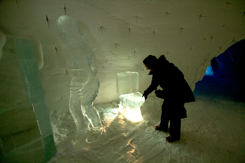 Visitor to the Snow Hotel in Kirkenes, Norway, tries out a toilet sculpted of ice