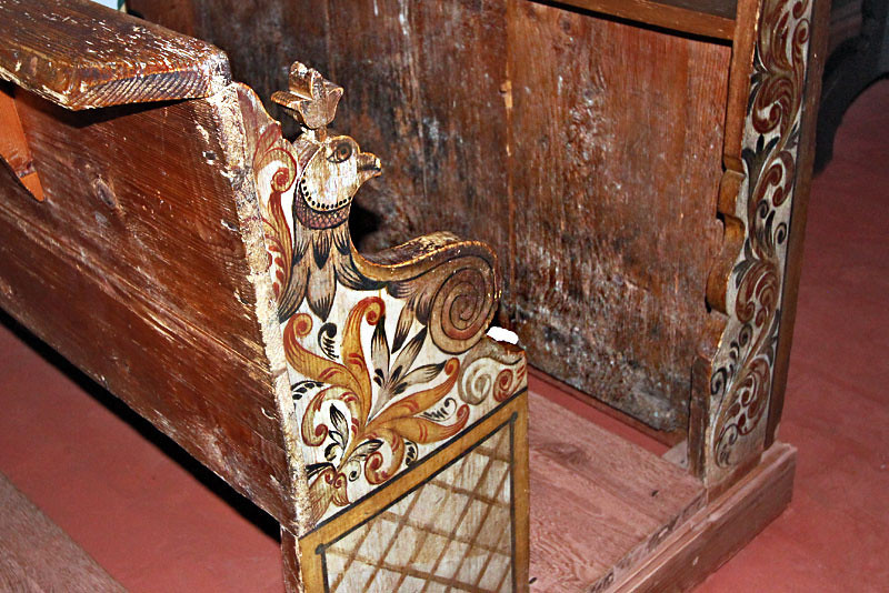 Intricate carving on pews at the historic wooden church at Takos, Hungary, dates to Medieval times