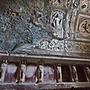 The Forum Public Baths at Pompeii, Italy, where frescoes and sculptures of gods and mythology decorate the walls and arched ceiling of the Tepedarium