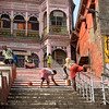 Workers paint the shared steps between Vijayana Garam Ghat and Kedar Ghat in Varanasi, India