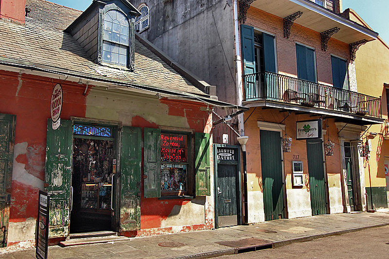 Colorful old buildings line Bourbon Street in New Orleans