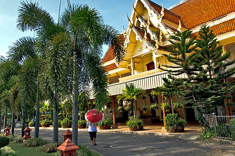 Strolling the exquisitely landscaped grounds of Wat Phra Singh in Chiang Mai, Thailand