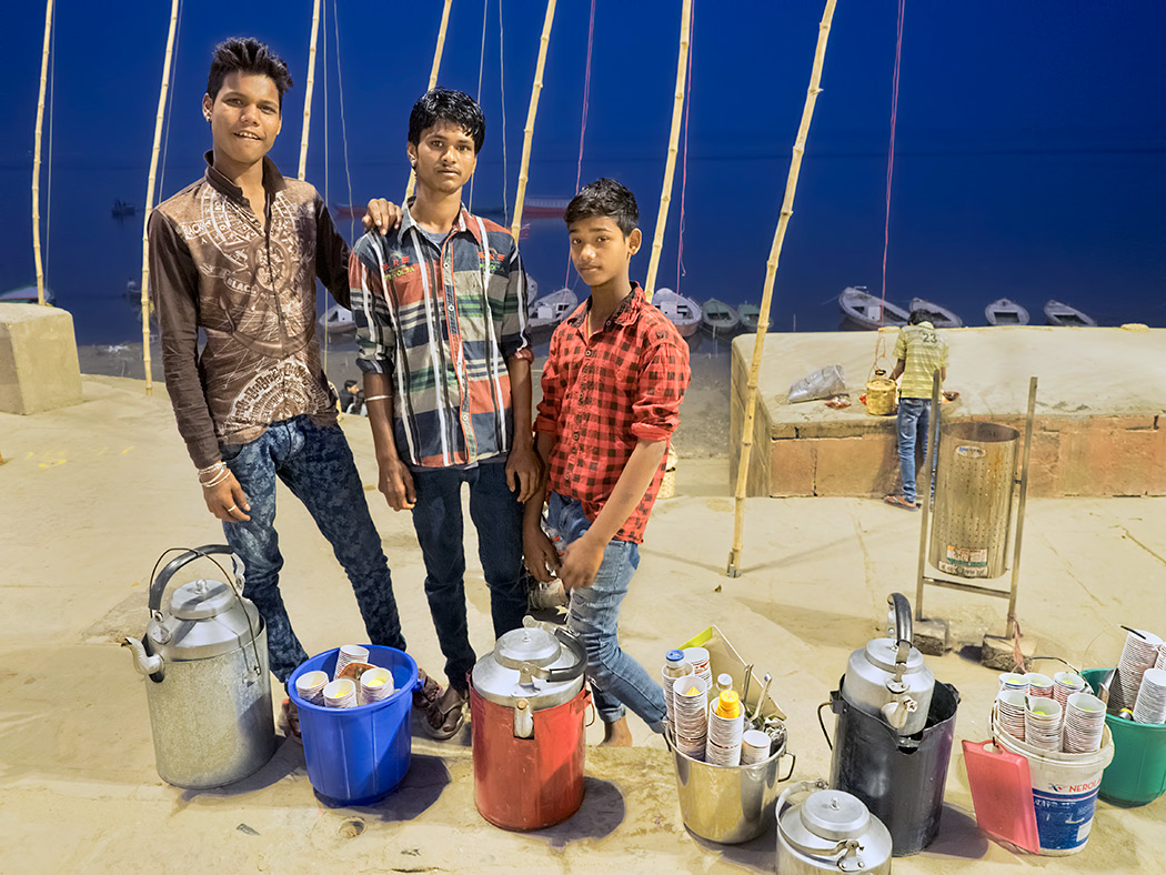 Boys at Assi Ghat in Varanasi, India, prepare to sell food and drinks to visitors who come to the ghat for the evening Fire Purifying Ceremony