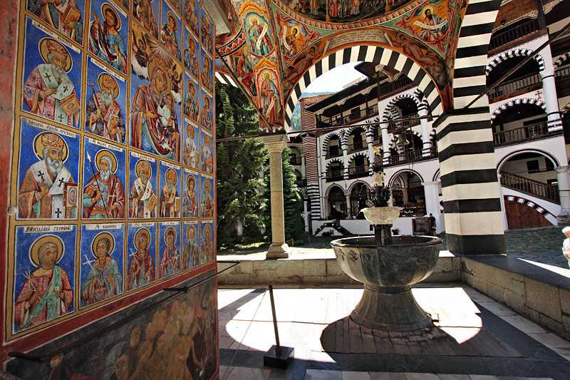 Frescoes and fountain in the front cloister of the church at Rila Monastery in Bulgaria
