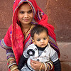 Mother and child take a break from walking under a blistering sun at the Red Fort of Agra in Agra, India