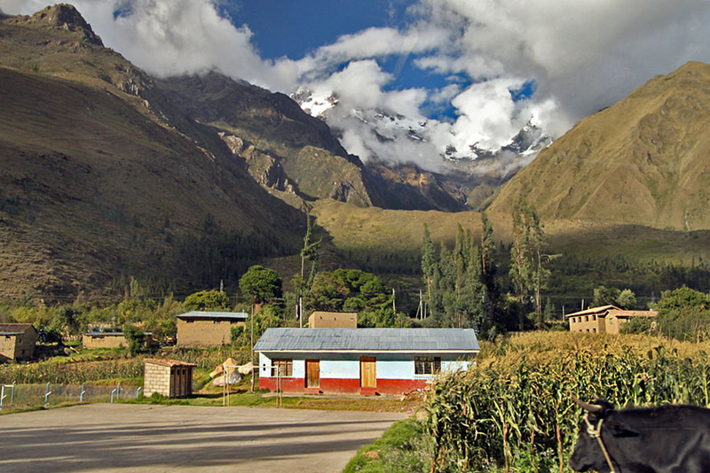Mountains tower over the Sacred Valley during train ride to Machu Picchu, Peru