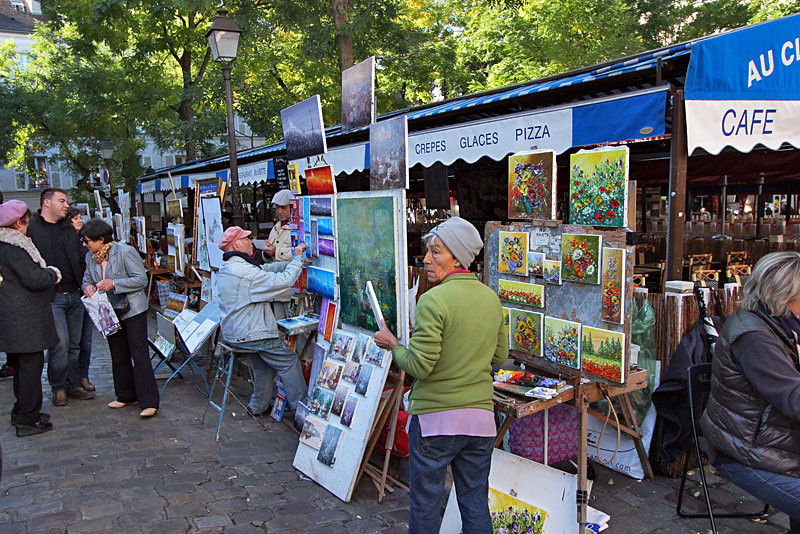 Artists work in the Montmartre neighborhood of Paris, France
