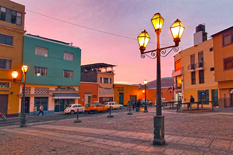Old-fashioned street lights provide romantic lighting at sunset in Trujillo, Peru