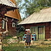Woman in the far northern Romanian village of Breb returns from the fields with bags of produce for dinner