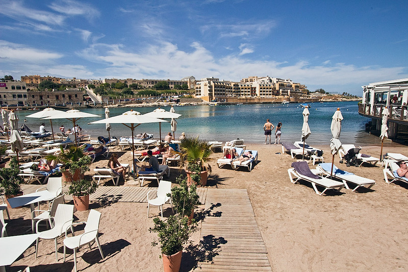Pocket beach in Paceville, the 'party central' city on the island of Malta