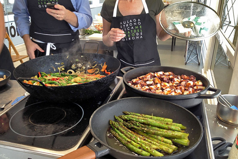 Sauteed veggies with sesame, asparagus, and octopus with olive oil and paprika, all typical Catalonian foods