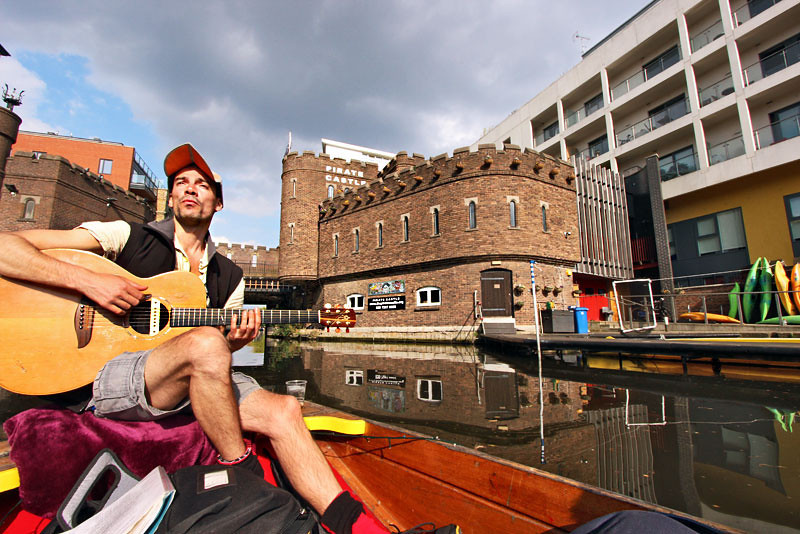 Guitarist sings as we paddle down the Regency Canal from Camden Lock to London Zoo
