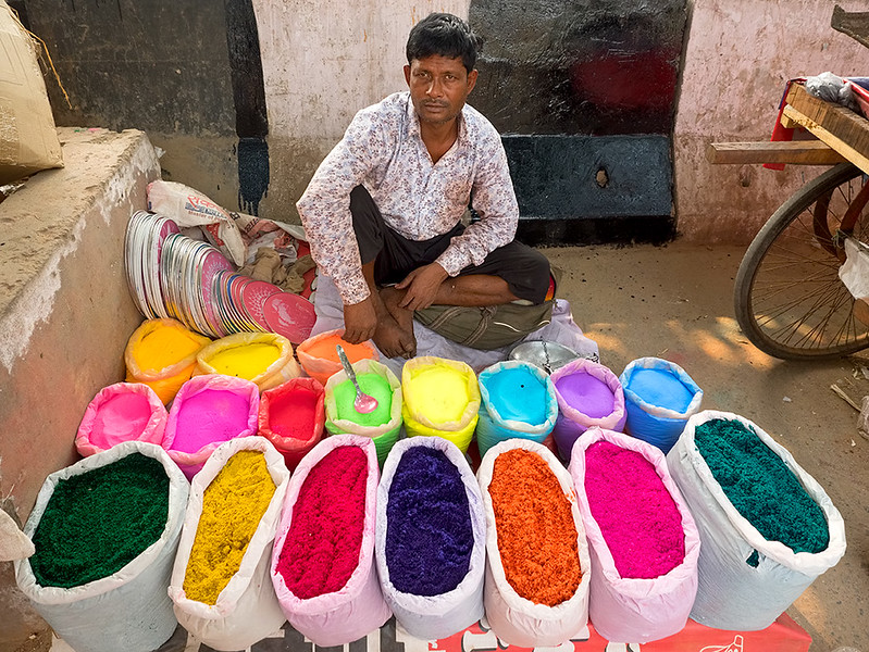 Vendor sells colored powder for Diwali celebrations at the Lajpat Nagar Central Market in Delhi, India