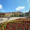 Summer flower gardens and historic restored homes line Kossuth Square in Debrecen, Hungary