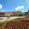 Summer flower gardens and historic restored homes line Kossuth Square in Debrecen, Hungary