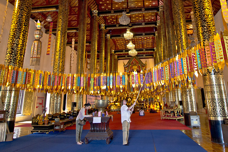 For good luck, worshipers hang ribbons in the grand viharn at Wat Chedi Luang in Chiang Mai, Thailand