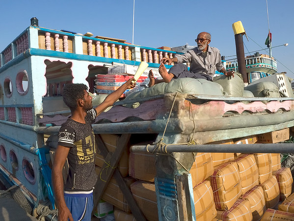 Dhow cargo boat on Dubai Creek in Dubai, UAE, is loaded down and ready to haul anchor