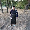 Woman in the small village of Yasna Polyana, Bulgaria wears traditional costume of shepherdess