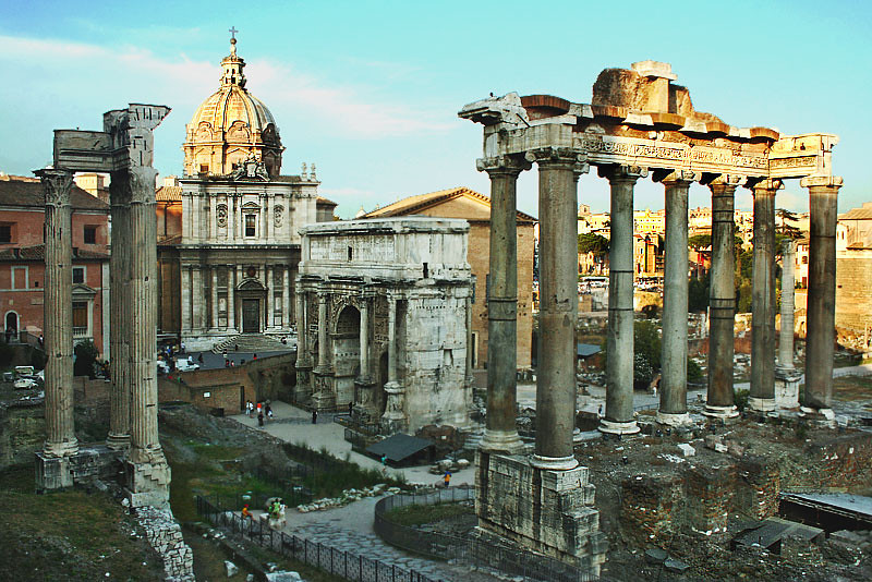 Last Rays of Setting Sun Illuminate Rips of Buildings at the Forum in Rome, Italy