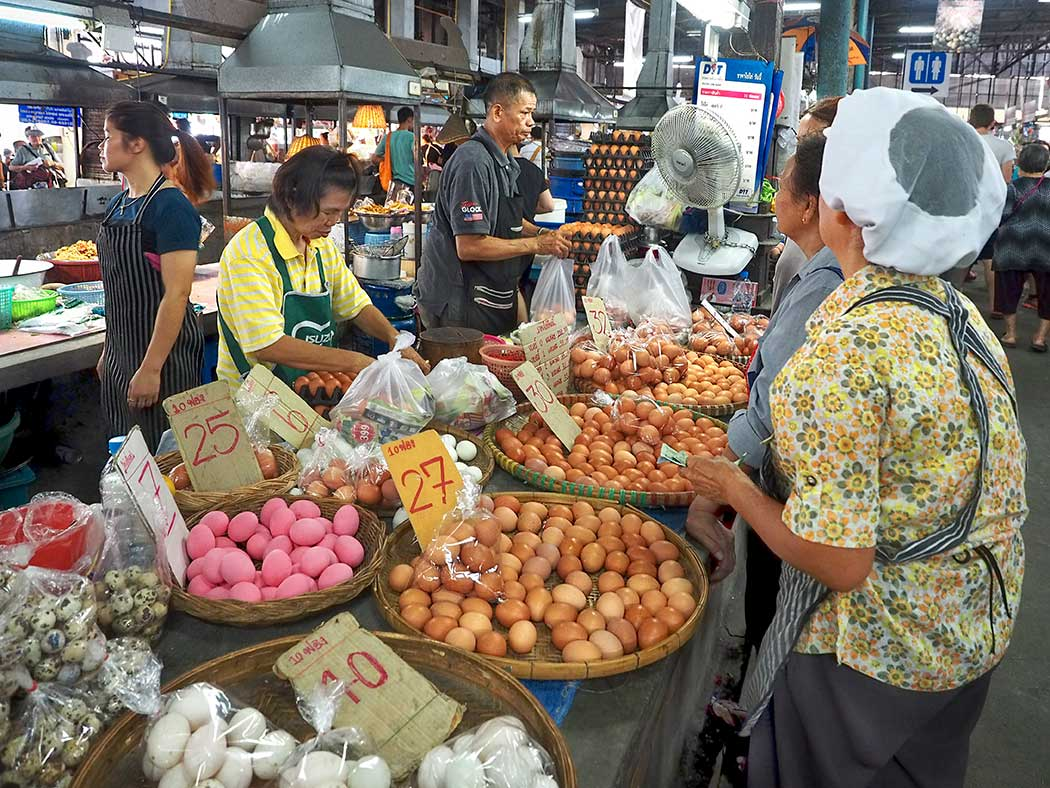 Egg sellers serve customers at the Chiang Mai Gate market each morning. Unlike the U.S., eggs are not refrigerated in Thailand, which made me wonder,