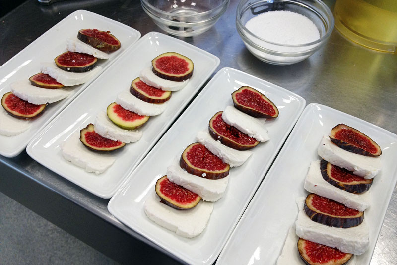 Goat cheese with fresh fig slices, one of the appetizers in our cooking class in Girona, Spain