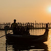 In Mandalay, Myanmar, sun sets behind U Bein Bridge, said to be the longest and oldest teak bridge in the world