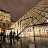 Illuminated pyramid at Louvre Museum, Paris France