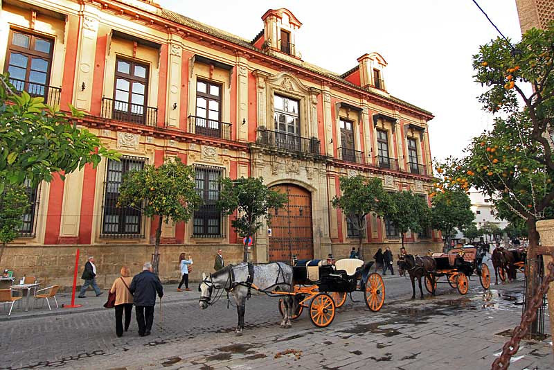 Horse-drawn carriages in Plaza Virgen de los Reyes in Seville, Spain