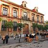 Horse-drawn carriages in Plaza Virgen de los Reyes in Seville, Spain