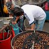 Roasting chestnuts on Petaling Street in Chinatown in Kuala Lumpur, Malaysia