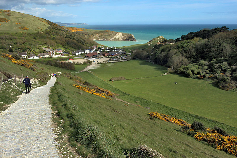 View of perfectly circular Lulworth Cove from atop the South Coast Path near West Lulworth