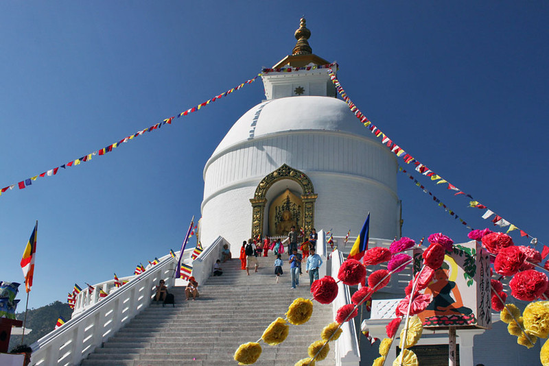 The World Peace Pagoda perches atop a hill that overlooks Pokhara, Nepal and lovely Phewa Lake