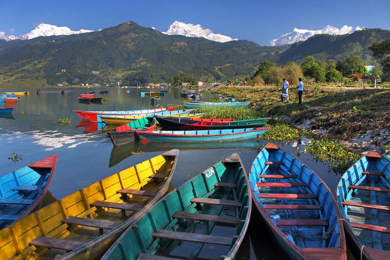 Colorful boats on Phewa Lake in Pokhara, Nepal