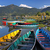 Colorful boats on Phewa Lake in Pokhara, Nepal